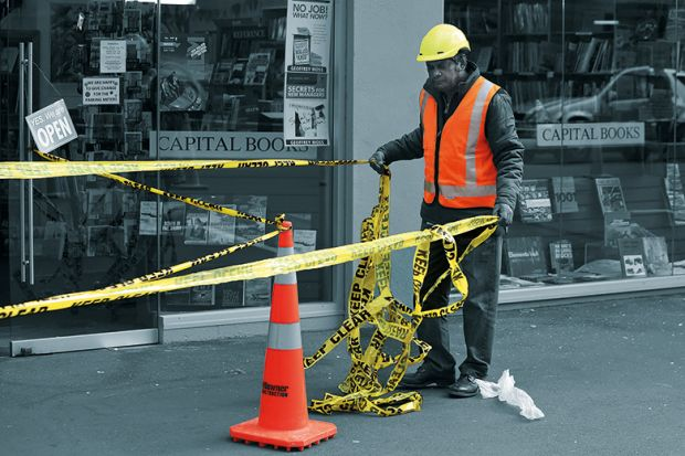 Worker putting up barrier tape