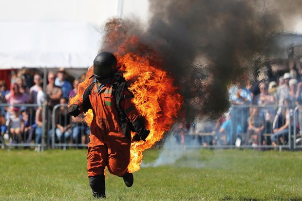 Man in hazard suit on fire