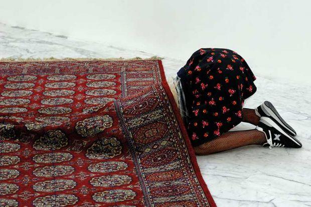 hiding-under-rug