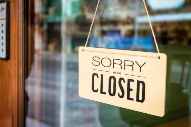 Sign saying: 'Sorry, we are closed'
