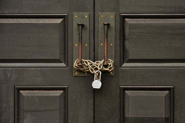 a padlocked door, campuses closed in Germany