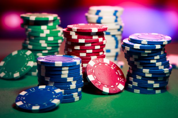 Stacks of casino chips on table