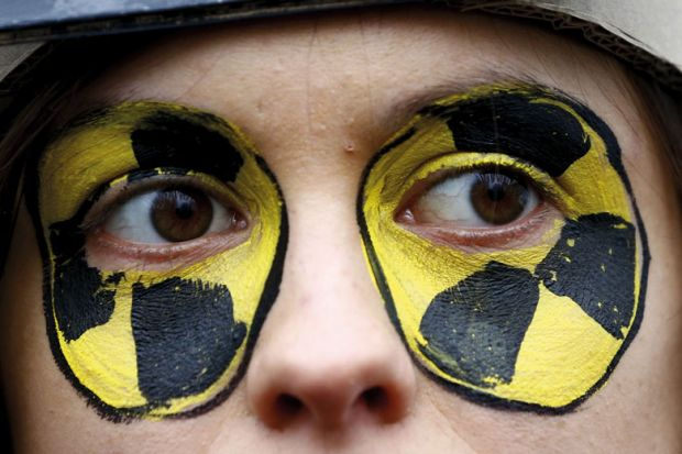 Close up of face with eyes painted circles yellow and black