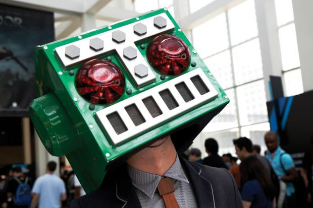 A man in a Destructoid costume on his head as Stanford students sour on big tech careers amid ethics concerns